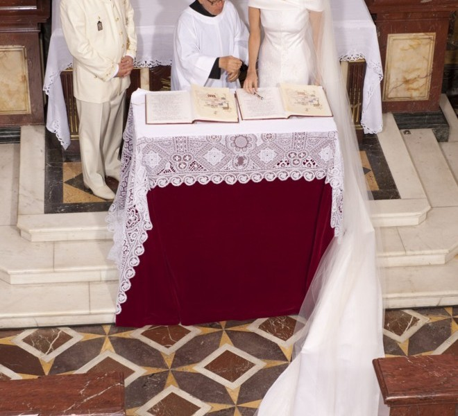 Prince Albert II of Monaco and Princess Charlene of Monaco sign the register at the Sainte Devote Church where Princess Charlene left her bouquet after their religious wedding on July 2, 2011 in Monaco. AFP PHOTO / POOL PALAIS PRINCIER / Gaetan LUCI