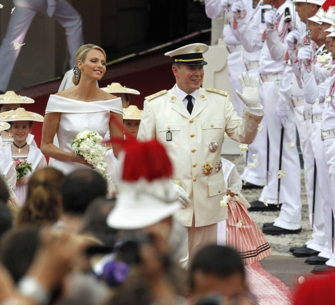Prince Albert II of Monaco and Princess Charlene of Monaco leave the Prince's Palace after their religious wedding on July 2, 2011 in Monaco.  AFP PHOTO / PATRICK KOVARIK
