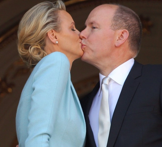 Prince Albert II of Monaco kisses Princess Charlene of Monaco on the balcony after their civil wedding at the Prince's Palace on July 1, 2011 in Monaco.  AFP PHOTO / VALERY HACHE