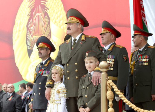 Belarus' President Alexander Lukashenko (C) stands on July 3, 2011 in Minsk during a military parade in celebration of Independence Day marking the anniversary of the end of Nazi occupation in 1944. Belarus President Alexander Lukashenko warned his opponents Sunday against considering any uprising against his rule as the military staged a Soviet-style show of force in an Independence Day parade. AFP PHOTO / BELTA / POOL/ NIKOLAI PETROV