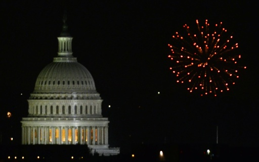 Fireworks go off behind the US Capitol building on 04 July, 2011 as the United States celebrate Independence Day,  a US federal holiday. Independence Day commemorates the day the Declaration of Independence was adopted by the continental congress in 1776, marking independence from Great Britain and the beginning of democracy.    AFP PHOTO / Eva HAMBACH