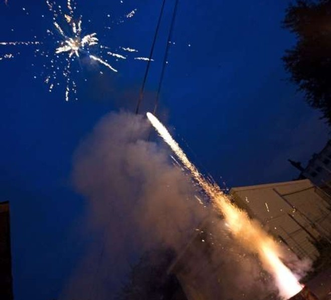 People set off fireworks on July 4, 2011 as the US celebrates Independence Day in Washington.     AFP PHOTO/Nicholas KAMM