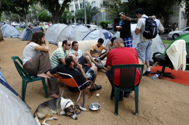 Israeli demonstrators walk at a tent camp in the centre of Tel Aviv on July 21, 2011 to protest against the rising prices of real estate in Israel. AFP PHOTO/MENAHEM KAHANA , A dog sits next to Israeli demonstrators sleeping at a tent camp in the centre of Tel Aviv on July 21, 2011 to protest against the rising prices of real estate in Israel. AFP PHOTO/MENAHEM KAHANA , Israeli demonstrators meditate at a tent camp in the centre of Tel Aviv on July 21, 2011 to protest against the rising prices of real estate in Israel. AFP PHOTO/MENAHEM KAHANA , An Israeli man walks past demonstrators sleeping at a tent camp in the centre of Tel Aviv on July 21, 2011 to protest against the rising prices of real estate in Israel. AFP PHOTO/MENAHEM KAHANA , Israeli demonstrators sleep at a tent camp in the centre of Tel Aviv on July 21, 2011 to protest against the rising prices of real estate in Israel. AFP PHOTO/MENAHEM KAHANA , Israeli flags flutter as demonstrators sleep at a tent camp in the centre of Tel Aviv on July 21, 2011 to protest against the rising prices of real estate in Israel. AFP PHOTO/MENAHEM KAHANA , An Israeli demonstrator uses an Israeli flag as a blanket while sleeping at a tent camp in the centre of Tel Aviv on July 21, 2011 to protest against the rising prices of real estate in Israel. AFP PHOTO/MENAHEM KAHANA , An Israeli rests on a bed set out amid dozens of tents pitched in the center of Tel Aviv on July 18, 2011, in protest against the rising prices of real estate in Israel. AFP PHOTO/MENAHEM KAHANA , A child looks at a flag as Israelis sit amid dozens of tents pitched in the center of Tel Aviv on July 18, 2011, in protest against the rising prices of real estate in Israel. AFP PHOTO/MENAHEM KAHANA , An Israeli protester uses his flag as a blanket as demonstrators sleep at a tent camp pitched in the centre of Tel Aviv on July 21, 2011 to protest against the rising prices of real estate in Israel. AFP PHOTO/MENAHEM KAHANA , Israelis sit amid dozens of tents pitched in the center of Tel Aviv on July 18, 2011, in protest against the rising prices of real estate in Israel. AFP PHOTO/MENAHEM KAHANA , Israelis sit outside dozens of tents pitched in the center of Tel Aviv on July 17, 2011 in protest against the rising prices of real estate in Israel. AFP PHOTO/DAVID BUIMOVITCH