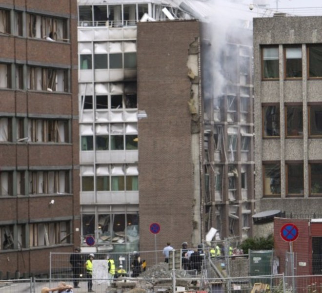 "TOPSHOTS Smoke rises from a building after a powerful bomb blast rocked government and media buildings in Norway's capital Oslo on July 22, 2011, causing ""deaths and injuries"" and dealing heavy damage, police said. Police said a bomb was behind the explosion and Norwegian media reported that at least two people died. TOPSHOTS / AFP PHOTO / JAN JOHANNESSEN"