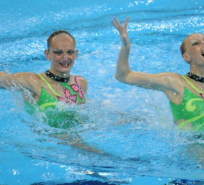 Ukraine's Daria Iushko and Kseniya Sydorenko compete in the final of the duets free synchronised swimming competition in the FINA World Championships at the indoor stadium of the Oriental Sports Centre in Shanghai on July 22, 2011. AFP PHOTO / PHILIPPE LOPEZ