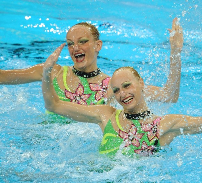 Ukraine's Daria Iushko and Kseniya Sydorenko compete in the preliminary round of the duets sychronised swimming competition in the FINA World Championships at the indoor stadium of the Oriental Sports Centre in Shanghai on July 19, 2011. AFP PHOTO / PETER PARKS