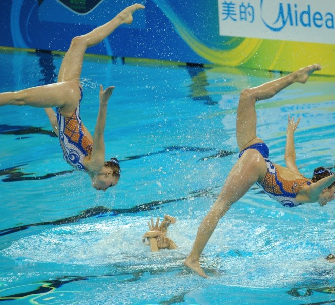 Ukraine's synchronised swimming team compete in the technical teams final synchronised swimming competition in the FINA World Championships at the indoor stadium of the Oriental Sports Center, in Shanghai, on July 19, 2011.      AFP PHOTO / PETER PARKS