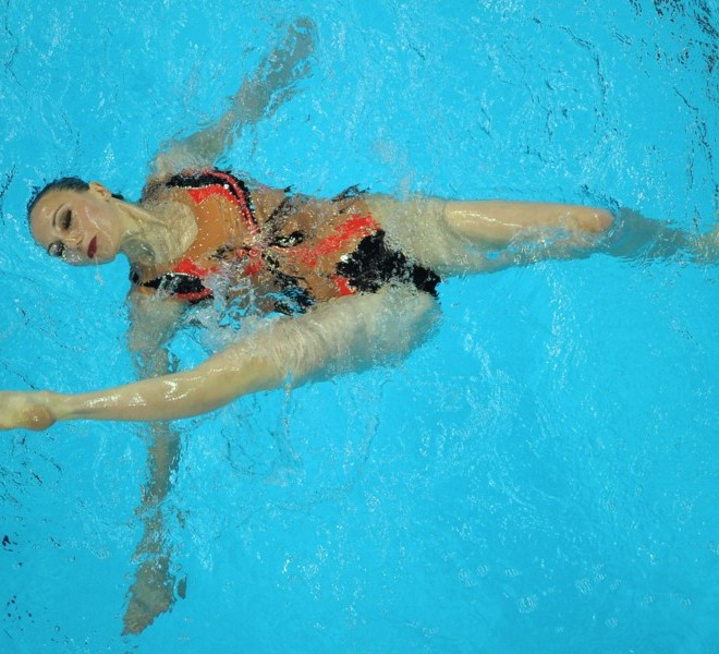 Ukraine's Lolita Ananasova competes in the final of the solo free synchronised swimming competition in the FINA World Championships at the indoor stadium of the Oriental Sports Centre in Shanghai on July 20, 2011. AFP PHOTO / PETER PARKS
