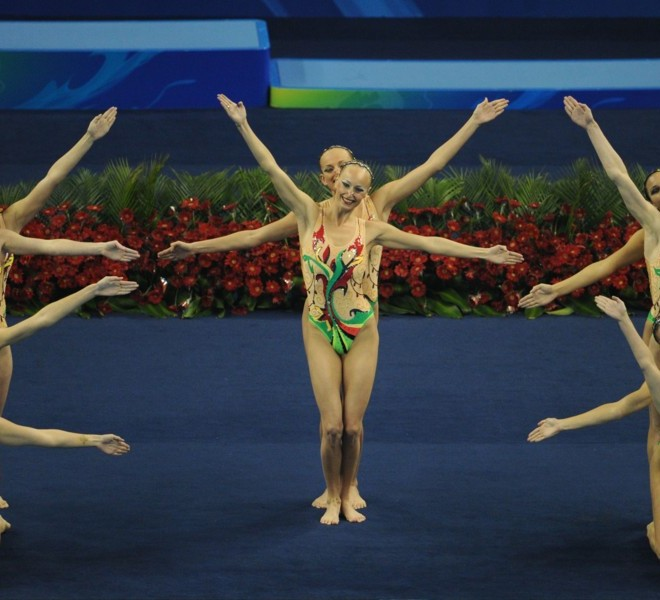 Ukraine's synchronised swimming team compete in the free combination final synchronised swimming competition in the FINA World Championships at the indoor stadium of the Oriental Sports Center, in Shanghai, on July 21, 2011. AFP PHOTO / MARK RALSTON