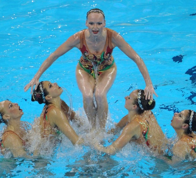 Members of the Ukraine's synchronised swimming team compete in the free combination final synchronised swimming competition in the FINA World Championships at the indoor stadium of the Oriental Sports Center, in Shanghai, on July 21, 2011. AFP PHOTO / MARK RALSTON