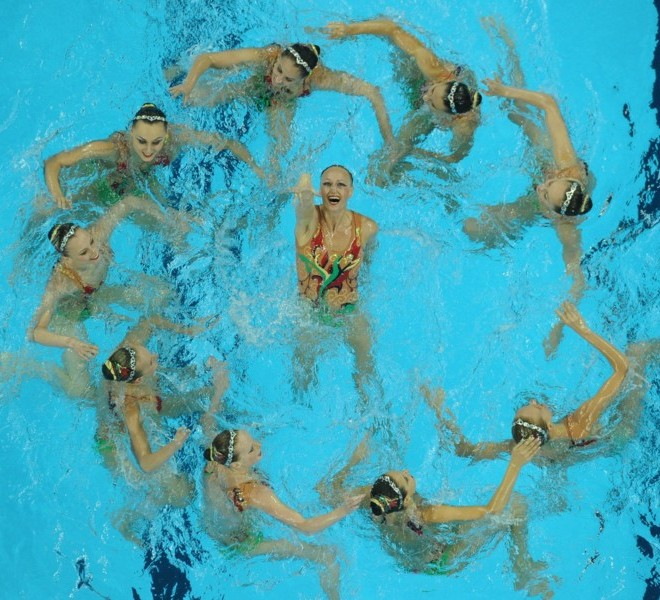 Ukraine's synchronised swimming team compete in the final of the free combination synchronised swimming competition in the FINA World Championships at the indoor stadium of the Oriental Sports Centre in Shanghai on July 21, 2011. AFP PHOTO / PETER PARKS