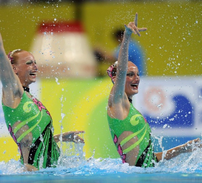 Ukraine's Daria Iushko and Kseniya Sydorenko compete in the final of the duets free synchronised swimming competition in the FINA World Championships at the indoor stadium of the Oriental Sports Centre in Shanghai on July 22, 2011. AFP PHOTO / FRANCOIS XAVIER MARIT