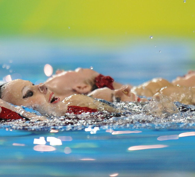 Ukraine competes in the final of the team free synchronised swimming event in the FINA World Championships at the indoor stadium of the Oriental Sports Centre in Shanghai on July 23, 2011.  AFP PHOTO / FRANCOIS XAVIER MARIT