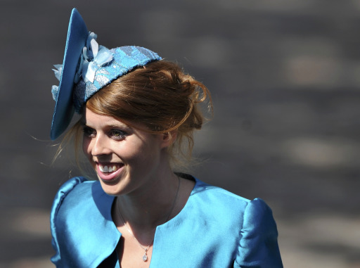 Princess Beatrice arrives for the wedding between England rugby player Mike Tindall and Zara Phillips, the eldest granddaughter of Britain's Queen Elizabeth II, at Canongate Kirk in Edinburgh, Scotland July 30, 2011. The couple, both world-beating sports stars, tie the knot at Edinburgh's Canongate Kirk in a private ceremony mid-afternoon that has little in common with that of Phillips' cousin, Prince William, when he married the former Kate Middleton three months ago.    AFP PHOTO / DYLAN MARTINEZ/POOL