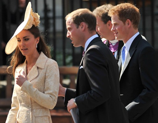 Catherine, the Duchess of Cambridge, (L) Prince William (2nd L) and Prince Harry (R) leave Canongate Kirk in Edinburgh, Scotland, on July 30, 2011, after attending the wedding of Zara Phillips, granddaughter of Queen Elizabeth II, and England rugby player Mike Tindall. AFP PHOTO / BEN STANSALL