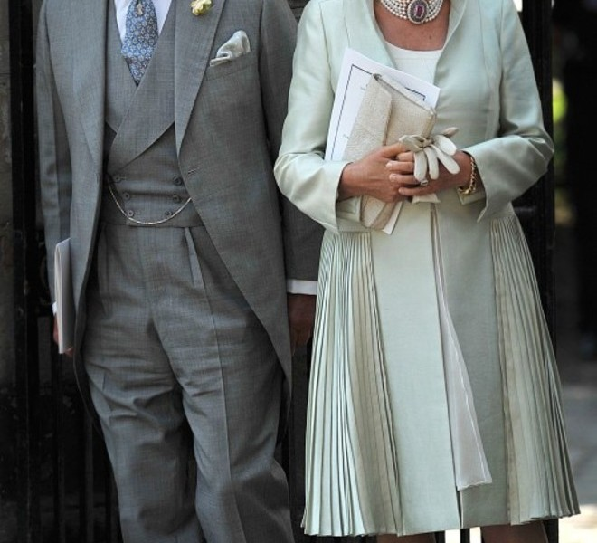 Britains's Prince Charles (L) and Camilla, Duchess of Cornwall, leave after attending the wedding between England rugby player Mike Tindall and Britain's Zara Phillips, granddaughter of Queen Elizabeth II, at Canongate Kirk in Edinburgh, Scotland, on July 30, 2011. AFP PHOTO / BEN STANSALL