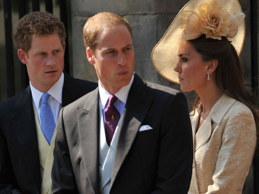 Britain's Catherine, Duchess of Cambridge, (R) Prince William (C) and Prince Harry, (L) leave after attending the wedding between England rugby player Mike Tindall and Britain's Zara Phillips, granddaughter of Queen Elizabeth II, at Canongate Kirk in Edinburgh, Scotland, on July 30, 2011.  AFP PHOTO / BEN STANSALL