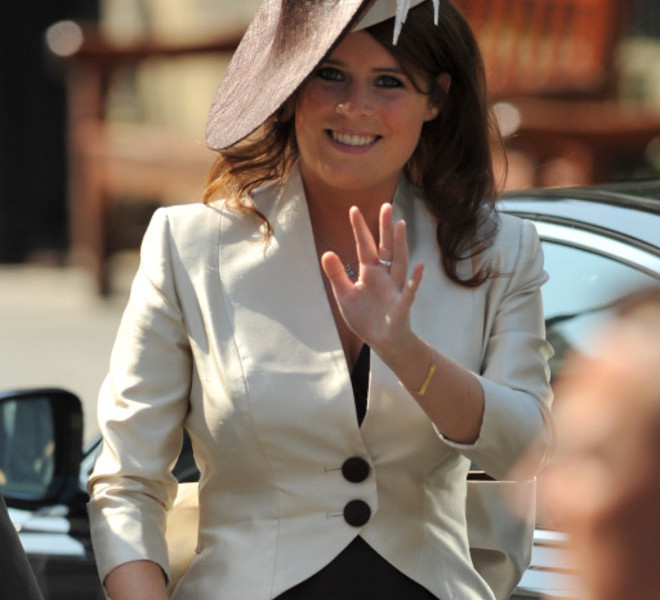 Princess Eugenie arrives for the wedding of Britain's Zara Phillips, granddaughter of Britain's Queen Elizabeth II, and England rugby player Mike Tindall at Canongate Kirk in Edinburgh, Scotland, on July 30, 2011. AFP PHOTO / BEN STANSALL