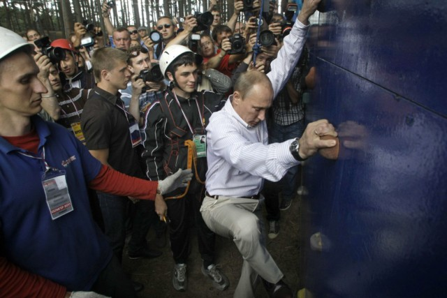 Russian Prime Minister Vladimir Putin scales a climbing wall during his visit at a summer camp run by the Nashi youth group at Lake Seliger in the central Tver region on August 1, 2011. Thousands of young activists from 84 regions of Russia gathered in the camp for the annual forum in Russia. AFP PHOTO / POOL / MIKHAIL METZEL , Russian Prime Minister Vladimir Putin scales a climbing wall during his visit at a summer camp run by the Nashi youth group at Lake Seliger in the central Tver region on August 1, 2011. Thousands of young activists from 84 regions of Russia gathered in the camp for the annual forum in Russia. AFP PHOTO / POOL / MIKHAIL METZEL