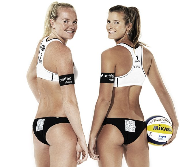 Shauna Mullin, 26, (L) and Zara Dampney, 24, (R) encourage spectators to photograph their behinds as they sign a deal with Betfair to advertise a Quick Response (QR) code on their bikini bottoms