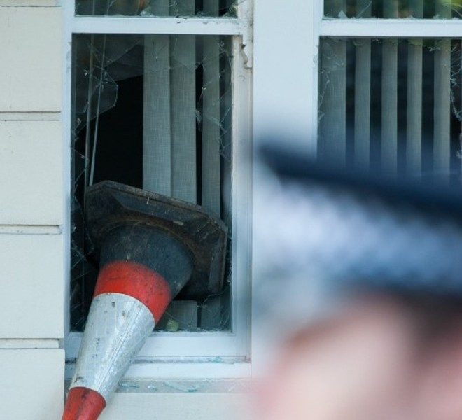 "A traffic cone lodged in a damaged window frame is pictured in Enfield, north London, following a second night of disturbances in London, on August 8, 2011. Police said Monday they had arrested 100 people in a second night of rioting in London, condemning it as ""copycat"" disorder following weekend unrest sparked by the death of a man in a police shooting. As violence which rocked the multi-ethnic northern district of Tottenham on Saturday spread to other districts of the capital, doubts emerged over the original version the shooting of 29-year-old Mark Duggan, with suggestions that officers were not under attack when they opened fire.  AFP PHOTO / Ki Price"