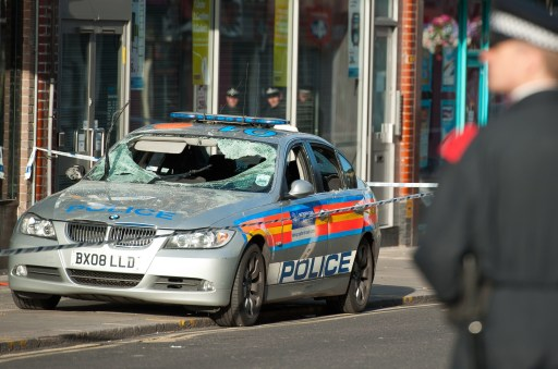 "A damaged police vehicle is pictured in Enfield, north London, following a second night of disturbances in London, on August 8, 2011. Police said Monday they had arrested 100 people in a second night of rioting in London, condemning it as ""copycat"" disorder following weekend unrest sparked by the death of a man in a police shooting. As violence which rocked the multi-ethnic northern district of Tottenham on Saturday spread to other districts of the capital, doubts emerged over the original version the shooting of 29-year-old Mark Duggan, with suggestions that officers were not under attack when they opened fire.  AFP PHOTO / Ki Price"