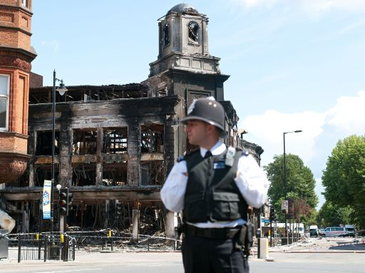 "The burnt remains of a building in Tottenham are pictured on August 8, 2011, after rioting in north London last Saturday night. Police said Monday they had arrested 100 people in a second night of rioting in London, condemning it as ""copycat"" disorder following weekend unrest sparked by the death of a man in a police shooting. As violence which rocked the multi-ethnic northern district of Tottenham on Saturday spread to other districts of the capital, doubts emerged over the original version the shooting of 29-year-old Mark Duggan, with suggestions that officers were not under attack when they opened fire.  AFP PHOTO / Ki Price"