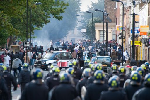 Riot police face a mob in Hackney, north London on August 8, 2011. Riot police faced off with youths in fresh violence in London today in the third day of disorder after some of the worst rioting in the British capital in years at the weekend. The riots broke out in the north London district of Tottenham on August 6, following a protest against the death of a local man in a police shooting last week, and the violence spread to other parts of the city on August 7.  AFP PHOTO/KI PRICE