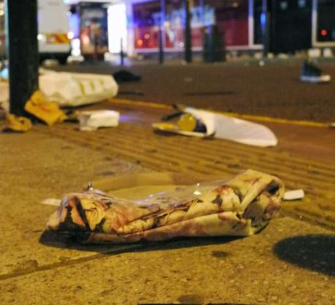 "A tag reading ""Carry On"" is shown laying on the pavement near looted shoes, clothes and hadbags in Clapham Junction, south London on 8 August 2011.  Now in it's third night of unrest, London has seen sporadic outbreaks of looting and clashes both north and south of the river Thames. Two police cars and a large number of buildings were on Saturday set ablaze in Tottenham, north London following a protest over the fatal shooting of a 29-year-old man in an armed stand-off with officers.  The patrol cars were torched as dozens gathered outside the police station on the High Road in Tottenham.AFP PHOTO/LEON NEAL"