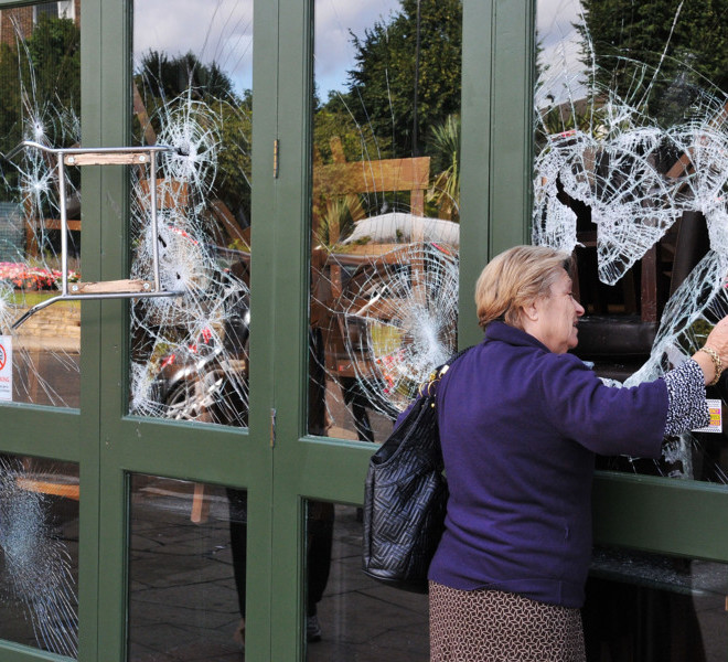 LONDON, ENGLAND - AUGUST 09:  A chair is left embedded in a restaurant window in Haven Green following a night of rioting in Ealing on August 9, 2011 in London, England. Sporadic looting, arson and clashes with police continued for a third day in parts of the capital, as well as in Liverpool, Birmingham and Bristol.  (Photo by Jim Dyson/Getty Images)