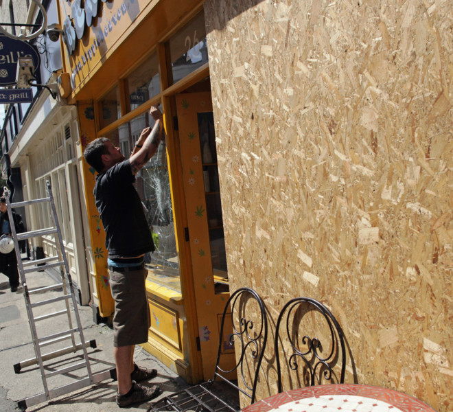 LONDON, ENGLAND - AUGUST 10:  Windows are replaced on shop properties in Ealing on August 10, 2011 in London, England. After three nights of rioting and looting in and around London, the chaos has spread to other cities around Britain.  (Photo by Dan Kitwood/Getty Images)