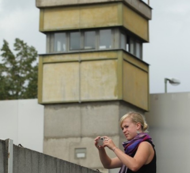 BERLIN, GERMANY - AUGUST 05:  A visitor standing on a ladder looks over a still-existing section of the Berlin Wall into the so-called 'death strip,' where East German border guards had the order to shoot anyone attempting to flee into West Berlin, as an original watchtower stands behind at the Bernauer Strasse memorial on August 5, 2011 in Berlin, Germany. The city of Berlin will mark the 50th anniversary of the construction of the Wall on August 13. The Berlin Wall was originally built in 1961 by the communist authorities of East Germany in order to stop East Germans from fleeing west, and up to an estimated 245 people died trying to do so until the Wall came down in 1989.   (Photo by Sean Gallup/Getty Images), BERLIN, GERMANY - AUGUST 10:  A costumed border guard stands in front of a poster near a still-existing section of the Berlin Wall, the so called East Side Gallery, where East German border guards once had the order to shoot anyone attempting to flee into West Berlin on August 10, 2011 in Berlin, Germany. The city of Berlin will mark the 50th anniversary of the construction of the Wall on August 13. The Berlin Wall was originally built in 1961 by the communist authorities of East Germany in order to stop East Germans from fleeing west, and up to an estimated 245 people died trying to do so until the Wall came down in 1989.  (Photo by Andreas Rentz/Getty Images), BERLIN, GERMANY - AUGUST 10:  Visitors watch through a metal door at a still-existing section of the Berlin Wall, where East German border guards once had the order to shoot anyone attempting to flee into West Berlin on August 10, 2011 in Berlin, Germany. The city of Berlin will mark the 50th anniversary of the construction of the Wall on August 13. The Berlin Wall was originally built in 1961 by the communist authorities of East Germany in order to stop East Germans from fleeing west, and up to an estimated 245 people died trying to do so until the Wall came down in 1989.  (Photo by Andreas Rentz/Getty Images), BERLIN, GERMANY - AUGUST 10:  Visitors ride past a still-existing section of the Berlin Wall, where East German border guards once had the order to shoot anyone attempting to flee into West Berlin on August 10, 2011 in Berlin, Germany. The city of Berlin will mark the 50th anniversary of the construction of the Wall on August 13. The Berlin Wall was originally built in 1961 by the communist authorities of East Germany in order to stop East Germans from fleeing west, and up to an estimated 245 people died trying to do so until the Wall came down in 1989.  (Photo by Andreas Rentz/Getty Images), BERLIN, GERMANY - AUGUST 10:  A still-existing section of the Berlin Wall, where East German border guards once had the order to shoot anyone attempting to flee into West Berlin is pictured on August 10, 2011 in Berlin, Germany. The city of Berlin will mark the 50th anniversary of the construction of the Wall on August 13. The Berlin Wall was originally built in 1961 by the communist authorities of East Germany in order to stop East Germans from fleeing west, and up to an estimated 245 people died trying to do so until the Wall came down in 1989.  (Photo by Andreas Rentz/Getty Images), BERLIN, GERMANY - AUGUST 05:  A guide instructs visitors at a still-existing section of the Berlin Wall, where East German border guards once had the order to shoot anyone attempting to flee into West Berlin, as an original watchtower stands behind at the Bernauer Strasse memorial on August 5, 2011 in Berlin, Germany. The city of Berlin will mark the 50th anniversary of the construction of the Wall on August 13. The Berlin Wall was originally built in 1961 by the communist authorities of East Germany in order to stop East Germans from fleeing west, and up to an estimated 245 people died trying to do so until the Wall came down in 1989.  (Photo by Sean Gallup/Getty Images), BERLIN, GERMANY - AUGUST 05:  A visitor looks over a still-existing section of the Berlin Wall into the so-called 'death strip,' where East German border guards once had the order to shoot anyone attempting to flee into West Berlin at the Bernauer Strasse memorial on August 5, 2011 in Berlin, Germany. The city of Berlin will mark the 50th anniversary of the construction of the Wall on August 13. The Berlin Wall was originally built in 1961 by the communist authorities of East Germany in order to stop East Germans from fleeing west, and up to an estimated 245 people died trying to do so until the Wall came down in 1989.  (Photo by Sean Gallup/Getty Images), BERLIN, GERMANY - AUGUST 05:  A visitor peeks through a still-existing section of the Berlin Wall into the so-called 'death strip,' where East German border guards had the order to shoot anyone attempting to flee into West Berlin at the Bernauer Strasse memorial on August 5, 2011 in Berlin, Germany. The city of Berlin will mark the 50th anniversary of the construction of the Wall on August 13. The Berlin Wall was originally built in 1961 by the communist authorities of East Germany in order to stop East Germans from fleeing west, and up to an estimated 245 people died trying to do so until the Wall came down in 1989.  (Photo by Sean Gallup/Getty Images), BERLIN, GERMANY - AUGUST 10:  Visitors walk past a still-existing section of the Berlin Wall, where East German border guards once had the order to shoot anyone attempting to flee into West Berlin on August 10, 2011 in Berlin, Germany. The city of Berlin will mark the 50th anniversary of the construction of the Wall on August 13. The Berlin Wall was originally built in 1961 by the communist authorities of East Germany in order to stop East Germans from fleeing west, and up to an estimated 245 people died trying to do so until the Wall came down in 1989.  (Photo by Andreas Rentz/Getty Images), BERLIN, GERMANY - AUGUST 10:  A visitor photographs a part of a still-existing section of the Berlin Wall, so called 'East Side Gallery', where East German border guards once had the order to shoot anyone attempting to flee into West Berlin on August 10, 2011 in Berlin, Germany. The city of Berlin will mark the 50th anniversary of the construction of the Wall on August 13. The Berlin Wall was originally built in 1961 by the communist authorities of East Germany in order to stop East Germans from fleeing west, and up to an estimated 245 people died trying to do so until the Wall came down in 1989.  (Photo by Andreas Rentz/Getty Images), BERLIN, GERMANY - AUGUST 10:  Visitors walk past a still-existing section of the Berlin Wall, the so called East Side Gallery, where East German border guards once had the order to shoot anyone attempting to flee into West Berlin on August 10, 2011 in Berlin, Germany. The city of Berlin will mark the 50th anniversary of the construction of the Wall on August 13. The Berlin Wall was originally built in 1961 by the communist authorities of East Germany in order to stop East Germans from fleeing west, and up to an estimated 245 people died trying to do so until the Wall came down in 1989.  (Photo by Andreas Rentz/Getty Images), BERLIN, GERMANY - AUGUST 10:  Visitors walk past a still-existing section of the Berlin Wall, where East German border guards once had the order to shoot anyone attempting to flee into West Berlin on August 10, 2011 in Berlin, Germany. The city of Berlin will mark the 50th anniversary of the construction of the Wall on August 13. The Berlin Wall was originally built in 1961 by the communist authorities of East Germany in order to stop East Germans from fleeing west, and up to an estimated 245 people died trying to do so until the Wall came down in 1989.  (Photo by Andreas Rentz/Getty Images), BERLIN, GERMANY - AUGUST 10:   A visitor photographs a part of a still-existing section of the Berlin Wall, where East German border guards once had the order to shoot anyone attempting to flee into West Berlin on August 10, 2011 in Berlin, Germany. The city of Berlin will mark the 50th anniversary of the construction of the Wall on August 13. The Berlin Wall was originally built in 1961 by the communist authorities of East Germany in order to stop East Germans from fleeing west, and up to an estimated 245 people died trying to do so until the Wall came down in 1989.  (Photo by Andreas Rentz/Getty Images), BERLIN, GERMANY - AUGUST 05:  A visitor walks along a still-existing section of the Berlin Wall, where East German border guards once had the order to shoot anyone attempting to flee into West Berlin, as an original watchtower stands behind at the Bernauer Strasse memorial on August 5, 2011 in Berlin, Germany. The city of Berlin will mark the 50th anniversary of the construction of the Wall on August 13. The Berlin Wall was originally built in 1961 by the communist authorities of East Germany in order to stop East Germans from fleeing west, and up to an estimated 245 people died trying to do so until the Wall came down in 1989.  (Photo by Sean Gallup/Getty Images), BERLIN, GERMANY - AUGUST 05:  A visitor standing on a ladder photographs over a still-existing section of the Berlin Wall into the so-called 'death strip,' where East German border guards had the order to shoot anyone attempting to flee into West Berlin, as an original watchtower stands behind at the Bernauer Strasse memorial on August 5, 2011 in Berlin, Germany. The city of Berlin will mark the 50th anniversary of the construction of the Wall on August 13. The Berlin Wall was originally built in 1961 by the communist authorities of East Germany in order to stop East Germans from fleeing west, and up to an estimated 245 people died trying to do so until the Wall came down in 1989.  (Photo by Sean Gallup/Getty Images)