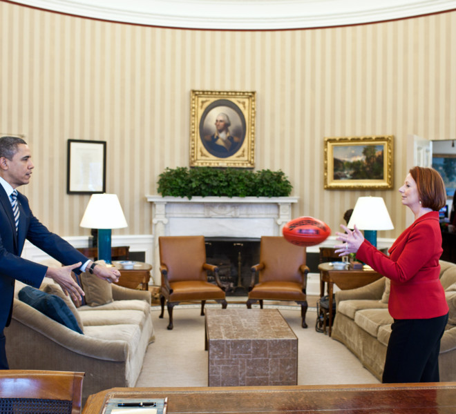 President Barack Obama practices passing a football with Prime Minister Julia Gillard of Australia in the Oval Office, March 7, 2011. Under Australian Football League rules, a player must hold the ball in front of them and punch it with a clenched fist in order to conduct a legal pass to another player. (Official White House Photo by Pete Souza)