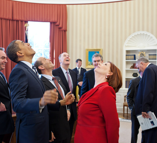 President Barack Obama, Prime Minister Julia Gillard of Australia, and members of the Australian and American delegations look up at the presidential seal in the Oval Office ceiling following their bilateral meeting, March 7, 2011. (Official White House Photo by Pete Souza)
