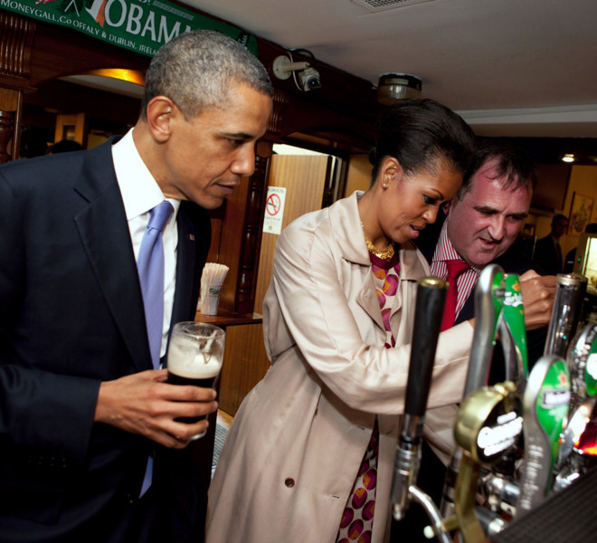 President Barack Obama watches as First Lady Michelle Obama draws a pint at Ollie Hayes? Pub in Moneygall, Ireland, May 23, 2011. (Official White House Photo by Pete Souza)