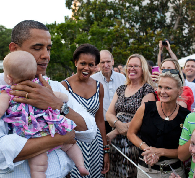 First Lady Michelle Obama reacts as President Barack Obama soothes a crying baby at the Congressional Picnic on the South Lawn of the White House, June 15, 2011. (Official White House Photo by Pete Souza)