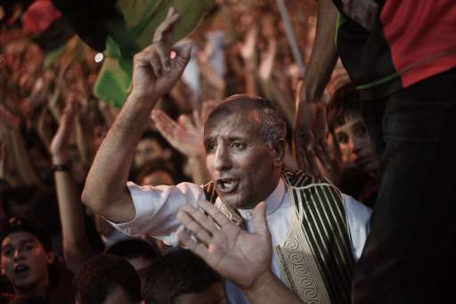 Tens of thousands of Libyans celebrate the arrest of Kadhafi's son Saif al-islam and the partial fall of Tripoli in the hands of the Libyan rebels on August 21, 2011 in Benghazi, Libya. AFP PHOTO/GIANLUIGI GUERCIA