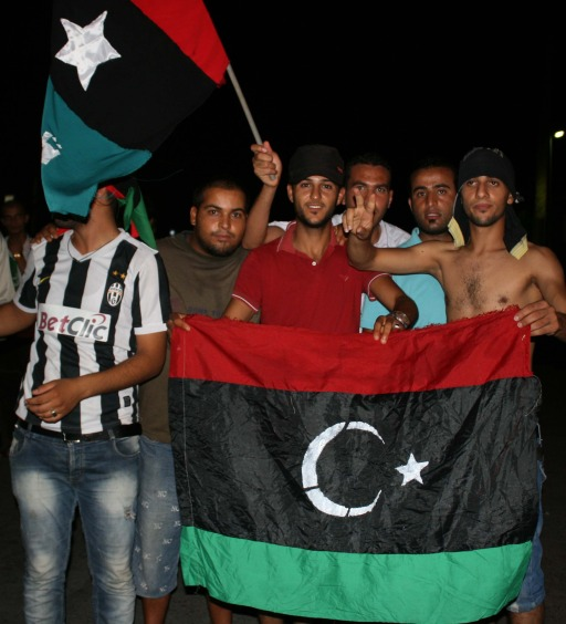 Rebels in Tajura, a suburb of Tripoli, celebrating the control, the entire area Tajoura, in the early morning on Monday, August 22, 2011.  Libyan rebels surged into Tripoli Sunday in a final drive to oust Moamer Kadhafi, seizing swathes of the capital including the symbolic Green Square and arresting the strongman's son, Seif al-Islam.    AFP PHOTO / STR
