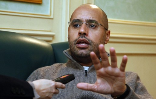 (FILES)--A February 26, 2011 file photo Saif al-Islam Kadhafi, son of Libyan leader Moamer Kadhafi, speaks during an interview with AFP in Tripoli. Libyan rebels were in the heart of Tripoli on August 22, 2011, after surging into the capital in a final drive to oust Moamer Kadhafi, seizing swathes of the city and arresting the strongman's son, Seif al-Islam. AFP PHOTO/MAHMUD TURKIA