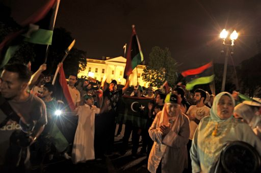 "Around one hundred Libyans on August 21,2011, in front of the White House, Washington DC, to celebrate Libya rebels surging into the heart of Tripoli. They sing: ""USA, USA, Kadhafi has gone today"" ""Kadhafi left Tripoli"", ""Libya is free"", and ""Merci Sarkozy, Merci Sarkozy, thank you Obama, thank you Obama"".  Libyan rebels were in the heart of Tripoli on August 21, 2011 after surging into the capital in a final drive to oust Moamer Kadhafi, seizing swathes of the city and arresting the strongman's son, Seif al-Islam.  AFP PHOTO / Stephan JOURDAIN"