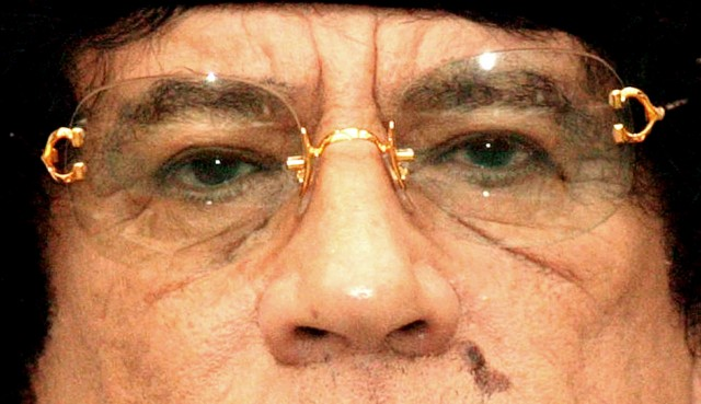 "TRIPOLI, LIBYA - FEBRUARY 5, 2001:  (FILE PHOTO)  Colonel Muammar al Gadhafi tells reporters that the guilty verdict of Abdel Baset Ali Megrahi in the 1988 Pam Am Flight 103 bombing trial was a farce and trivialized the evidence used to convict him February 5, 2001 in Tripoli, Libya. U.N. diplomats said August 12, 2003 that the U.S., Britain and Libya have reached an agreement that Gadhafi's government would renounce terrorism, provide compensation to the families of the Pan Am victims and accept responsibility for the 1988 mid-air bombing of the plane over Lockerbie, Scotland, which killed more than 270. The $2.7 billion settlement that Libya is expected to pay is about $10 million per victim and will be placed into the U.N.-controlled Bank for International Settlements in Switzerland. The three governments met August 11, 2003 in London to discuss how Libya could meet the final requirements needed for the removal of U.N. sanctions imposed after the bombing.  (Photo by Courtney Kealy/Getty Images), Libyan political and military leader Colonel Muammar Gaddafi in Majorca, Spain.    (Photo by Keystone/Getty Images), 23rd May 1976:  Colonel Muammar Gaddafi, shaking hands with Maltese people during a rally at Cospicua.  (Photo by Hulton Archive/Getty Images), 23rd May 1976:  Colonel Muammar al Gaddafi,  the Libyan political and military leader who returned the country to the fundamental principles of Islam.  (Photo by Keystone/Getty Images), ROME - AUGUST 30:  Libyan leader Muammar Gaddafi attends a ceremony for the Italia - Libya friendship day at Salvo D'Acquisto barracks, on August 30, 2010 in Rome, Italy.  Gadaffi is on an official two-day visit to Italy for talks with Prime Minister Silvio Berlusconi. The visit also marks the second anniversary of a friendship treaty between Italy and Lybia  (Photo by Giorgio Cosulich/Getty Images), A combo of file pictures created on April 20, 2011 shows Libyan leader Moamer Kadhafi. Kadhafi is facing an unprecedented challenge to his four-decade rule of the oil-rich North African country as forces loyal to his regime continue to battle rebels who have launched an uprising since mid February.  Moamer Kadhafi's 42-year rule in Libya is ""clearly crumbling,"" NATO Secretary General Anders Fogh Rasmussen said early Monday as rebels launched a fierce street battle for Tripoli in a final push for victory.    AFP PHOTO / - / FILES