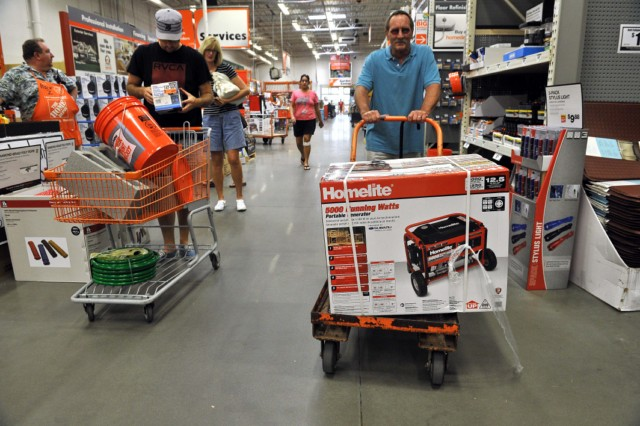 A man pushes a cart with a generator at a Home Depot store in Kitty Hawk in the North Carolina Outerbanks on August 25, 2011 ahead of the expected landfall in the area of Hurricane Irene. North Carolina declared a state of emergency as it braced for powerful Hurricane Irene, with a county ordering thousands of residents to evacuate.    AFP PHOTO/Nicholas KAMM