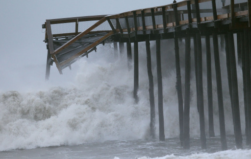 OCEAN CITY, MD - AUGUST 28: Large waves from Hurricane Irene pound the Ocean City pier on August 28, 2011 in Ocean City, Maryland. During the night Hurricane Irene past by the small resort town causing power outages, with minimal flood and wind damage.   Mark Wilson/Getty Images/AFP== FOR NEWSPAPERS, INTERNET, TELCOS & TELEVISION USE ONLY ==