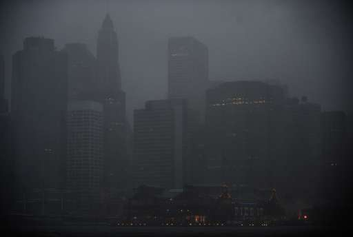 Manhattan is hit by Hurricane Irene, in New York, on August 28, 2011.  A weakened Hurricane Irene tore Sunday into New York, hammering Manhattan's skyscrapers with fierce winds and threatening to flood the financial district after killing at least nine people along the US east coast. AFP PHOTO / Emmanuel DUNAND
