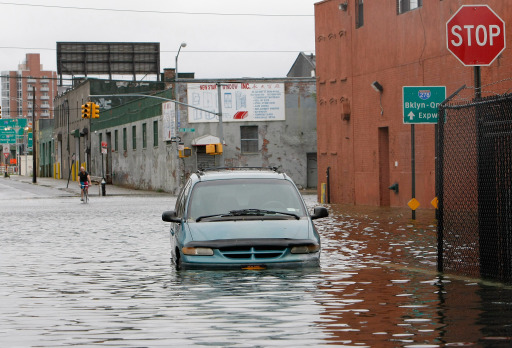 NEW YORK, NY - AUGUST 28: A van sits abandoned in the flood waters on Imlay Street in Red Hook in the aftermath of Hurricane Irene on August 28, 2011 in the Brooklyn borough of New York City. The hurricane hit New York as a Category 1 storm before being downgraded to a tropical storm.   Jemal Countess/Getty Images/AFP== FOR NEWSPAPERS, INTERNET, TELCOS & TELEVISION USE ONLY ==
