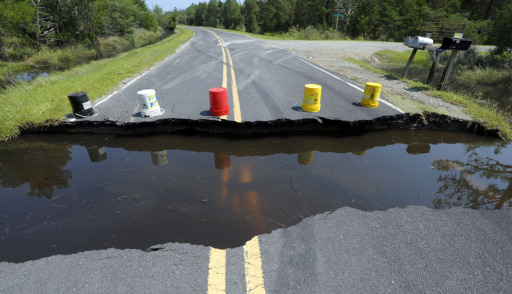 MESIC, NC - AUGUST 28: Buckets warn motorists where the road has washed out on August 28, 2011 in Mesic, North Carolina. Hurricane Irene made landfall in North Carolina creating a storm surge of up to eight feet in some areas of the Pamilco Sound.   Sara D. Davis/Getty Images/AFP== FOR NEWSPAPERS, INTERNET, TELCOS & TELEVISION USE ONLY ==