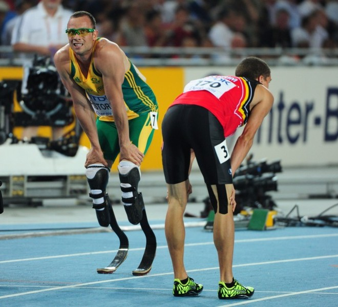 South Africa's Oscar Pistorius (L) reacts with Belgium's Jonathan Borlee after competing in the men's 400 metres semi-finals at the International Association of Athletics Federations (IAAF) World Championships in Daegu on August 29, 2011. AFP PHOTO / MARK RALSTON