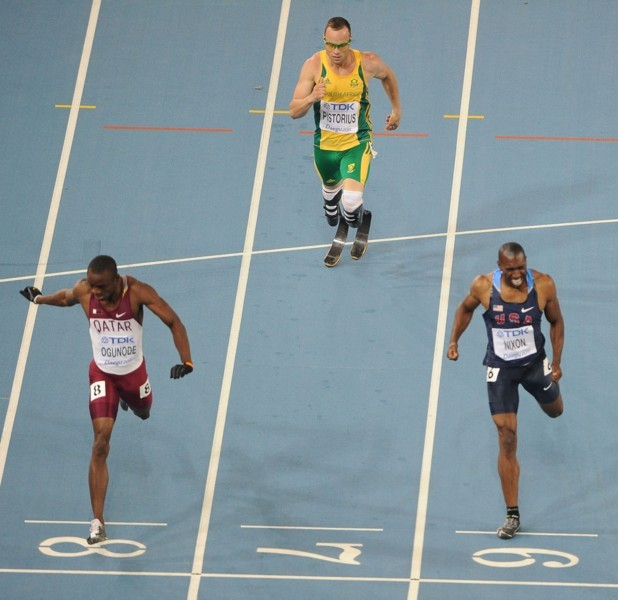 South Africa's Oscar Pistorius (C) competes with Qatar's Femi Ogunode (L) and US athlete Greg Nixon  in the men's 400 metres semi-finals at the International Association of Athletics Federations (IAAF) World Championships in Daegu on August 29, 2011.  AFP PHOTO / ANTONIN THUILLIER