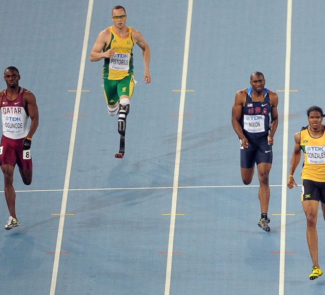South Africa's Oscar Pistorius (2L) competes with Qatar's Femi Ogunode (L), US athlete Greg Nixon (2R) and Jamaica's Jermaine Gonzales   in the men's 400 metres semi-finals at the International Association of Athletics Federations (IAAF) World Championships in Daegu on August 29, 2011.  AFP PHOTO / ANTONIN THUILLIER