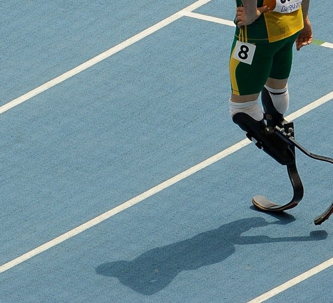 South Africa's Oscar Pistorius walks from the track at the end of his race in the men's 400 metres heats at the International Association of Athletics Federations (IAAF) World Championships in Daegu on August 28, 2011.   AFP PHOTO / ANTONIN THUILLIER